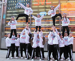 Cheerleaders of varying ages from Westchester's Gym City Lites performed in Times Square after marching in the NYC Veterans Day Parade this past November.