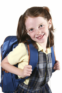 young girl in school uniform with backpack on
