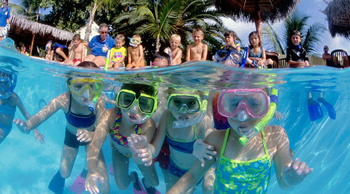 Kids snorkeling in Curacao, Caribbean