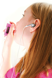 girl listening to iPod, electronics at summer camp