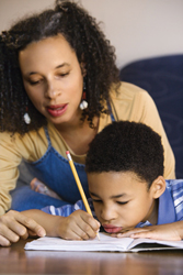 teach your child not to give up; mother encouraging son; mother and son doing homework
