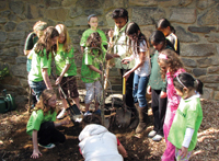 Earth Day; kids celebrating earth day; kids planting a tree; Greenburgh Nature Center