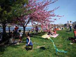 girl flying a kite; child and kite; kite flying contest; Socrates Sculpture Park
