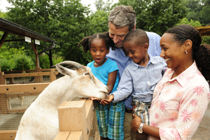 family at zoo; animal farm; goat; kids at the zoo