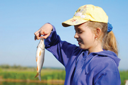 young girl holding a fish