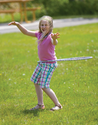 young girl with hula hoop