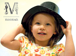 Moomah; little girl wearing a top hat