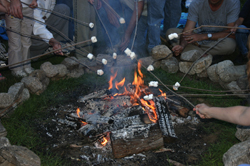 campfire; roasting marshmallows; making s'mores