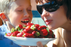 Mattituck Lions Club's Annual Strawberry Festival; Mattituck, Long Island; mother and son eating strawberries; fresh strawberries