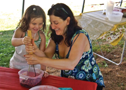 Fun on the Farm Day with Lil Chefs; little girl and mom make blueberry jam