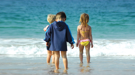 kids at the beach; children playing in the ocean