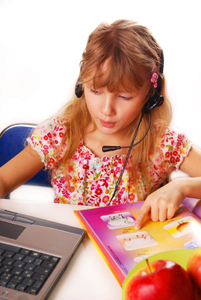 child learning a foreign language; young girl learning a second language