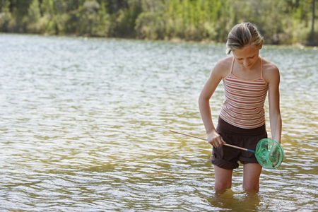 Teatown Lake Reservation; young girl wading in a lake with a net; girl fishing with a net