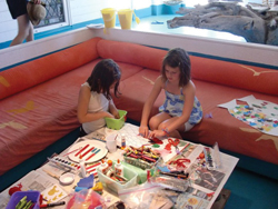 kids doing arts and crafts; two little girls making summer crafts; Surf Craft NY