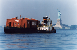 Tug and Barge Week, nyc; statue of liberty seen from boat; historic nyc barge