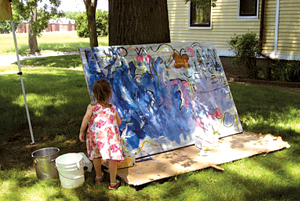 little girl painting outside; young girl doing art outside