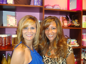 Lisa Falco-Gadzinski and Karen Falco-Pedra in front of the Bath Bakery Sweet Shoppe at A Girl's Gotta Spa in Patchogue, Long Island, NY