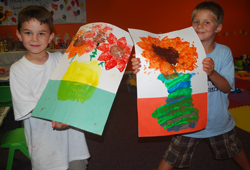 Tumbling Tunes Art Class; two young boys in art class; young artists