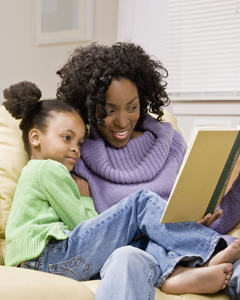mother reading to daughter; mom and daughter reading