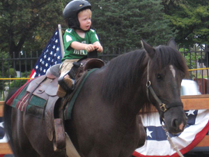Western Riding Club, Queens; small boy on a big horse