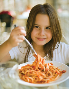 girl eating a big bowl of spaghetti