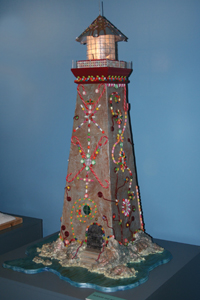 gingerbread lighthouse; lighthouse decorated for the holidays