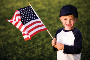 Veterans' Day; child holding American flag