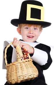 little boy dressed as pilgrim, holding indian corn; child in pilgrim costume