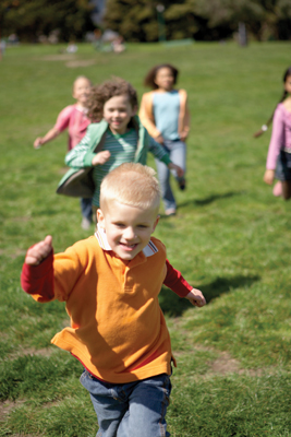 happy children running through a field
