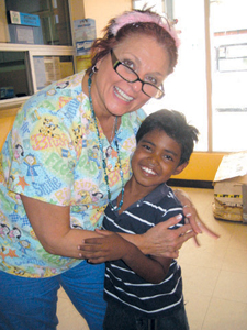 Linda Driscoll of Rockland Pediatric Dental with a young patient from Ecuador