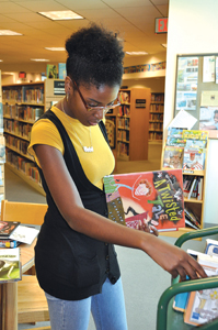 teen in library; Westcher library youth programs