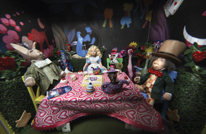Alice in Wonderland miniatures exhibit; mad hatter and brer rabbit at tea with alice