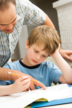 father tries to help son with homework; math homework