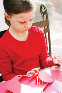 girl making a Valentine's Day card