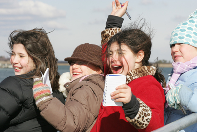 children on a winter seal cruise, long island; kids in a boat, on a winter cruise