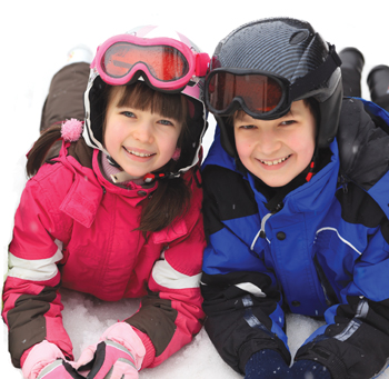 kids playing in the snow, wearing ski gear