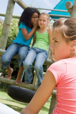 bullies; girls gossiping on the playground; girl being bullied