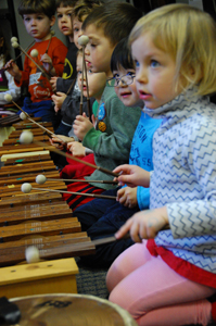 children in music class; kids play xylophone; third street music school