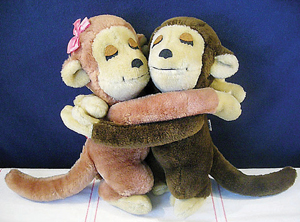 stuffed monkies hugging