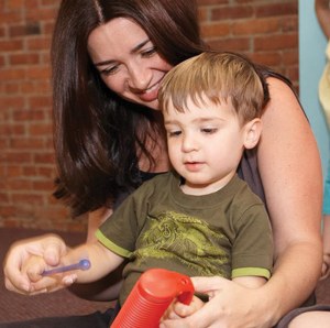 mommy and me music class; mom and son making music