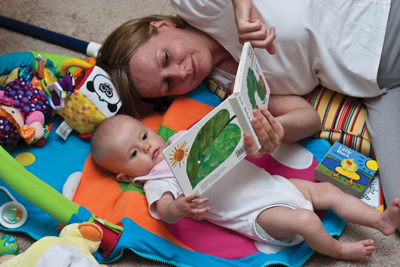 mom reading to baby; mother an infant reading a book
