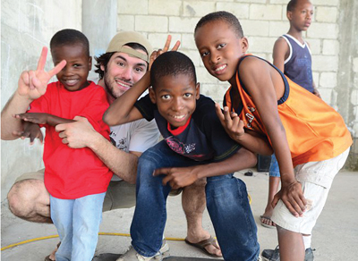 Photographer Darren Ornitz with Haitian children