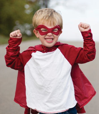 little boy dressed as superhero