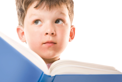 dyslexic child; boy reading a book