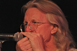 Peter Madcat Ruth plays the harmonica