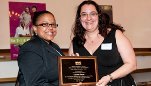 Foster parent Loretta Taylor receives her award from ACS Deputy Commissioner Lorraine Stephens