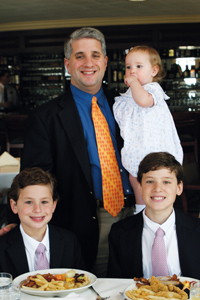 Paul Antico and his three children