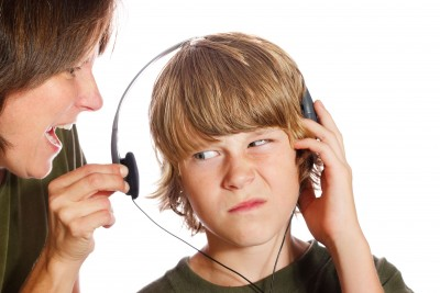 mom yelling at son wearing headphones