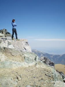 Mina Samuels climbing Mt. Dana