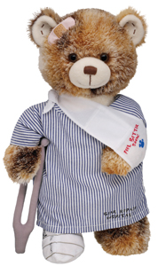 stuffed bear in hospital gown and arm sling